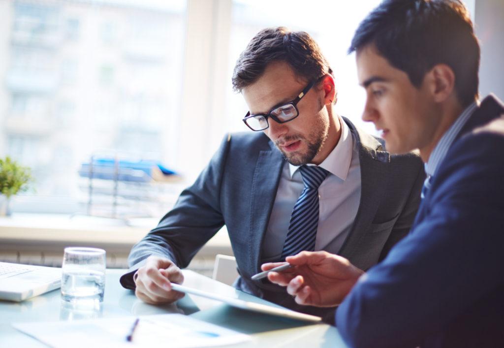 business men examining report