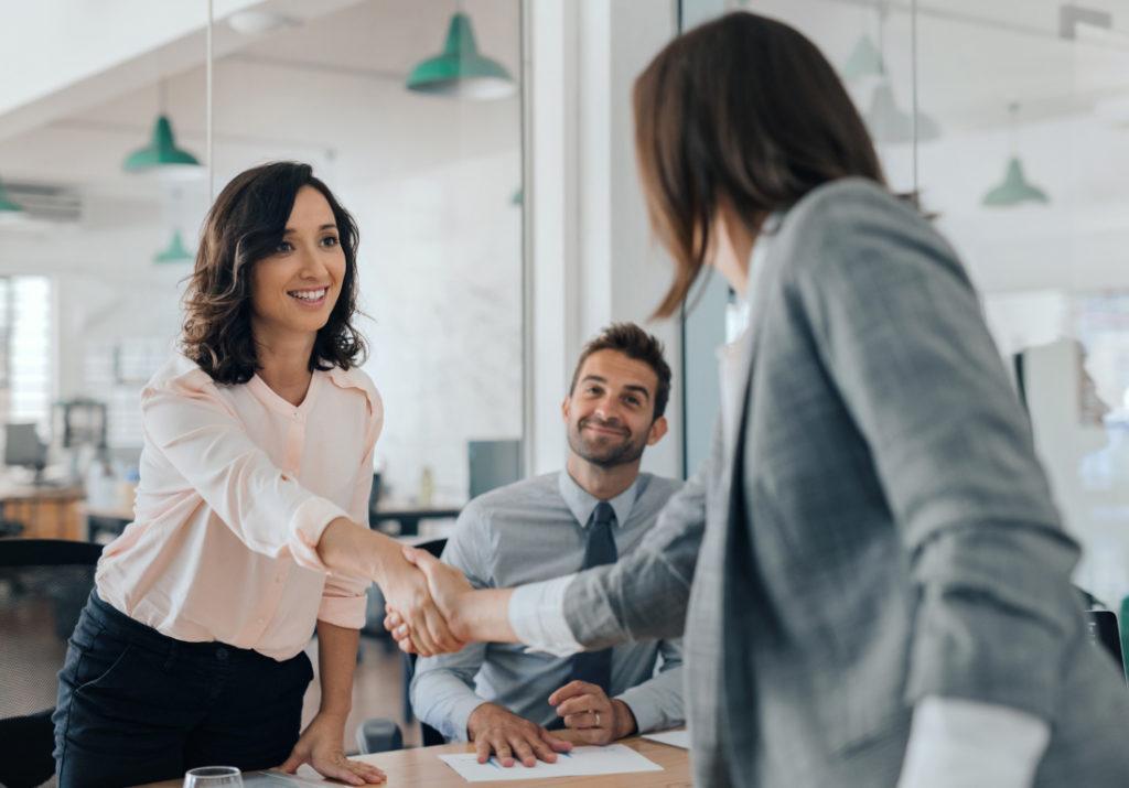 business women shaking hands